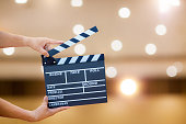 Man hands holding movie clapper.Film director concept.camera show viewfinder image catch motion in interview or broadcast wedding ceremony, catch feeling,woman hand hold a Film Slate over bokeh