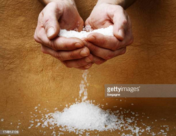 Man hands holding salt