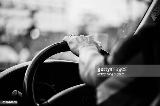 Man Hands On Steering Wheel
