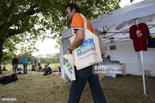 A man hands out bags promoting Action Against Hunger at the Subway Picnic Rocks festival on Clapham Common south London