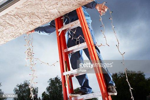 Man Hanging Christmas Lights