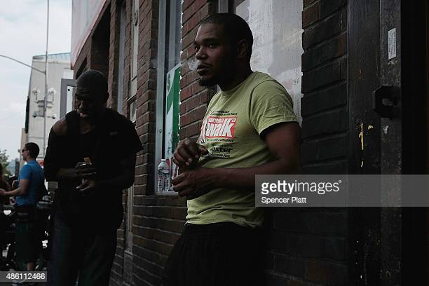 A man hangs out in an area which has witnessed an explosion in the use of K2 or 'Spice' a synthetic marijuana drug in East Harlem on August 31 2015...
