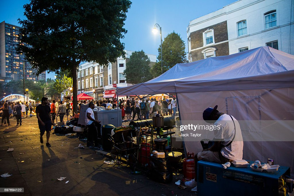 A man has a nap behind a food tent as Notting Hill Carnival comes to an end on August 29 2016 in London England The Notting Hill Carnival which has...