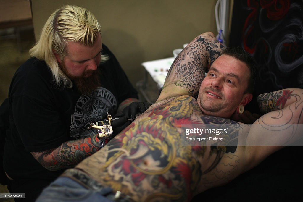 A man has a tattoo applied during The Tattoo Jam Festival on August 5, 2011 in Doncaster, England. The Tattoo Jam Festival is Britain's biggest gathering of tattoo professionals and skin art devotees. The event hosts over 300 artists working in the exhibition hall of Doncaster Racecourse revealing their latest designs and techniques.