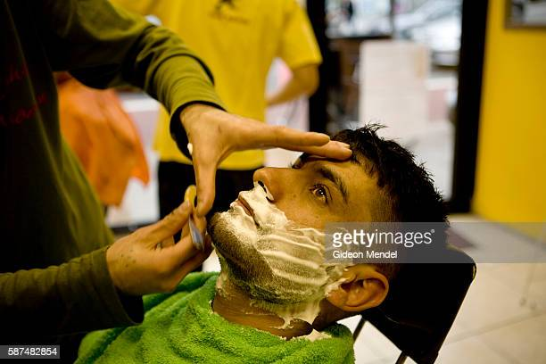 A man has a wet shave at a Turkish barbers shop on Kingsland Road in Hackney This area has a strong Turkish character and there are more than 35000...