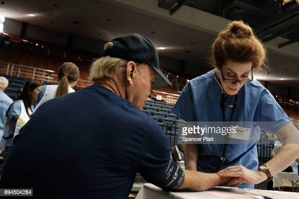 A man has his blood pressure checked at the Remote Area Medical mobile dental and medical clinic on June 10 2017 in Olean New York More than a...