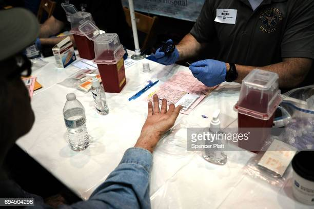 A man has his blood tested at the Remote Area Medical mobile dental and medical clinic on June 10 2017 in Olean New York More than a thousand people...
