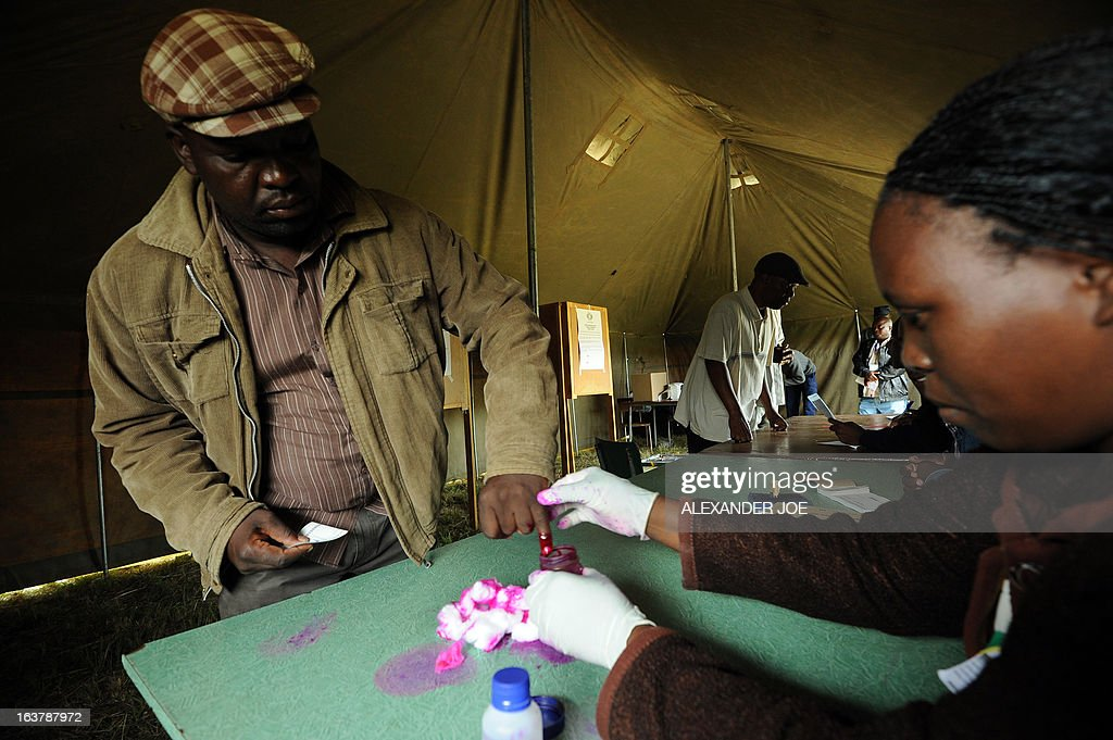 A man has his finger marked with a ink before voting in Chitungwiza on March 16, 2013, as voting kicked off for Zimbabweans referendum for a new constitution for the country, to adopt a new charter to pave way for new elections and a possible end to a shaky power-sharing government.