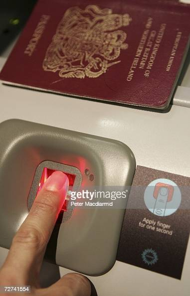 A man has his fingerprint scanned on a new biometric check in kiosk at terminal three on December 6 2006 at London's Heathrow airport The new check...