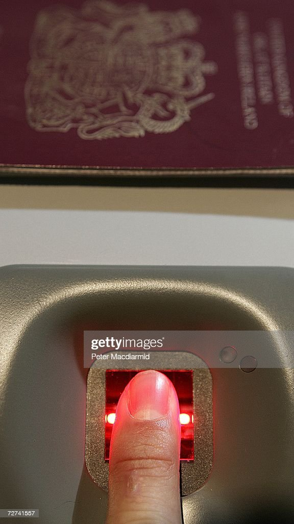 A man has his fingerprint scanned on a new biometric check-in kiosk at terminal three on December 6, 2006 at London's Heathrow airport, England. The new check-in kiosk allows passengers to link a fingerprint scan to their passport details and avoid long queues at security.