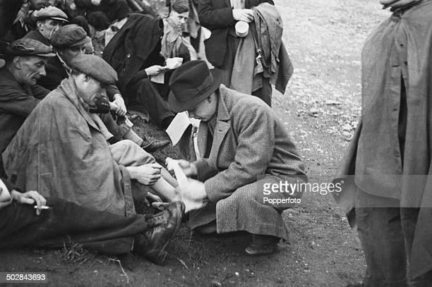 A man has his foot bandaged during the Jarrow March from NewcastleUponTyne to London October 1936 On arrival the marchers intend to present a...