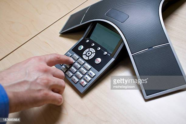 Man has meeting on a Conference Call phone
