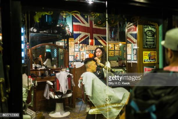 A man having a hair cut in the salon on June 24 2017 in Hong Kong Hong Kong Hong Kong is marking 20 years since the territory was handed from Britain...