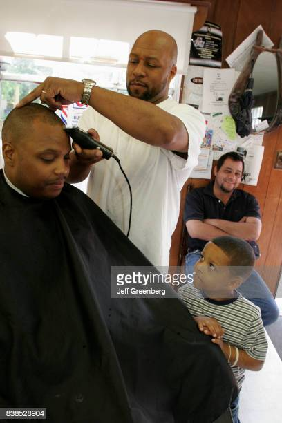 A man having a haircut in a barbers on Liberty Street