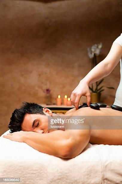 Man having a lastone therapy