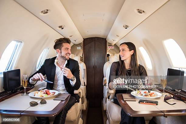 Man having a meal in private aeroplane