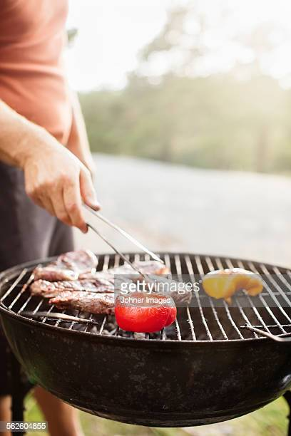 Man having barbecue