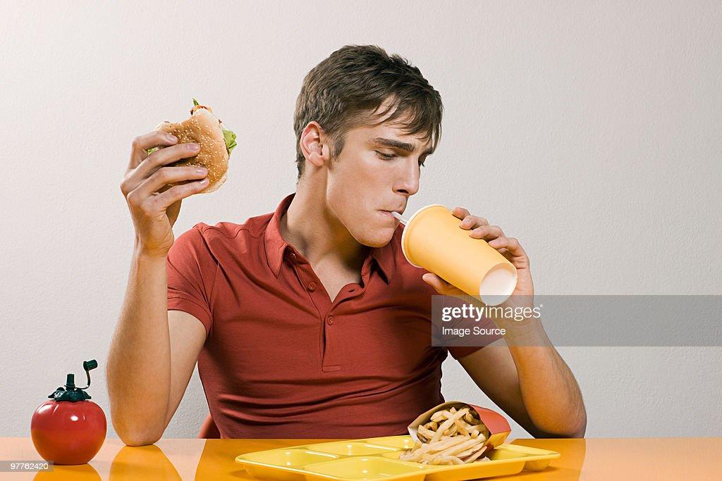 Man having burger meal : Stock Photo
