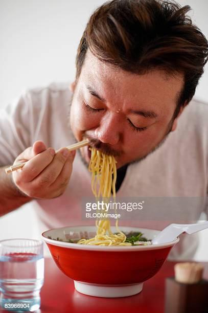 Man having Chinese noodles
