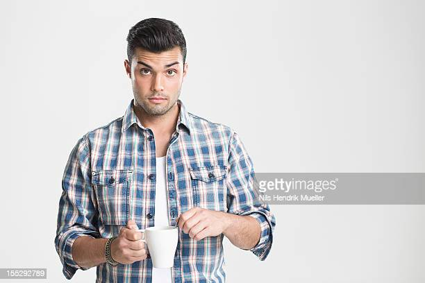 Man having cup of coffee