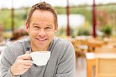 Man Having Cup Of Coffee