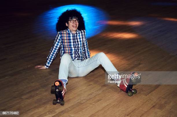 Man having fun at roller disco
