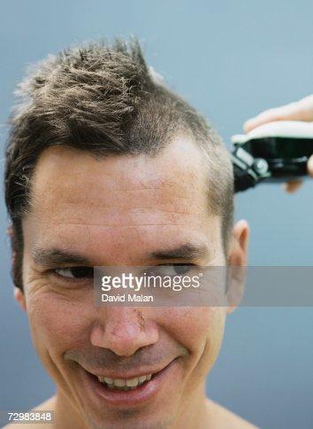 Man having haircut, close up,