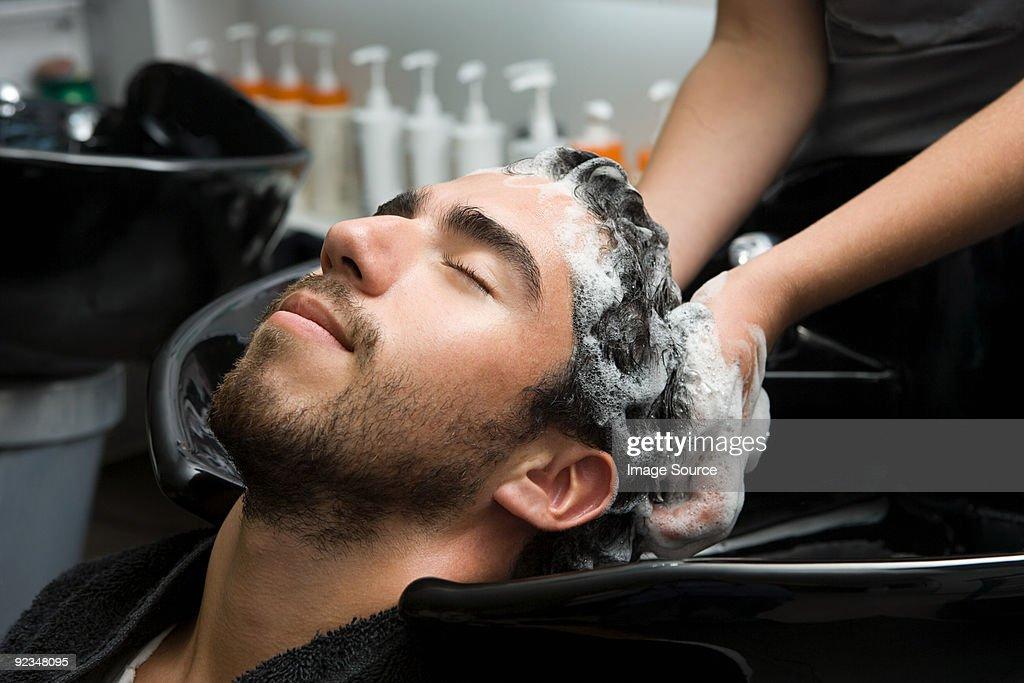 Man having his hair shampooed : Stock Photo