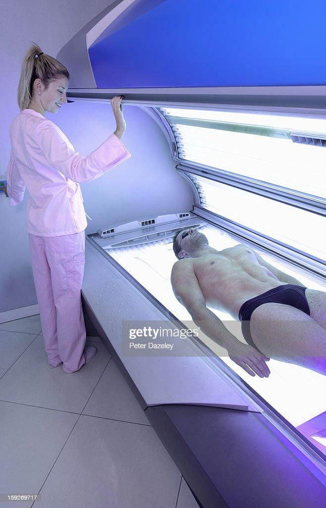 Man having lid put down on sunbed : Stock Photo