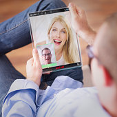 man having video call on the futuristic digital tablet