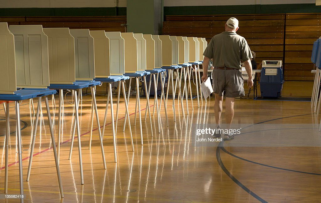 Man heading over to cast his ballot in the gym at Greenfield High School, which was a polling place for residents to vote, Greenfield, Massachusetts, USA 8 June 2010 : Stock Photo