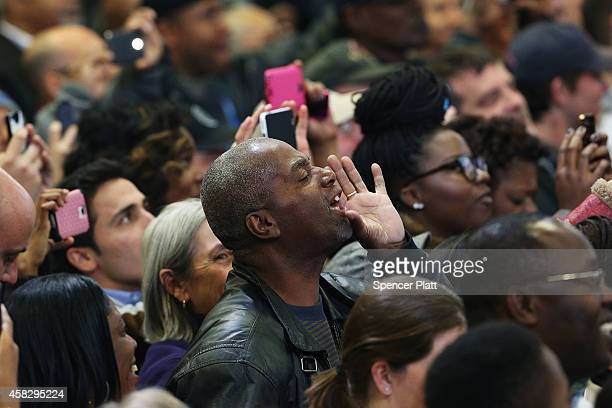 A man hecklers US President Barack Obama as he speaks in support of Connecticut Governor Dan Malloy on November 2 2014 in Bridgeport Connecticut On...