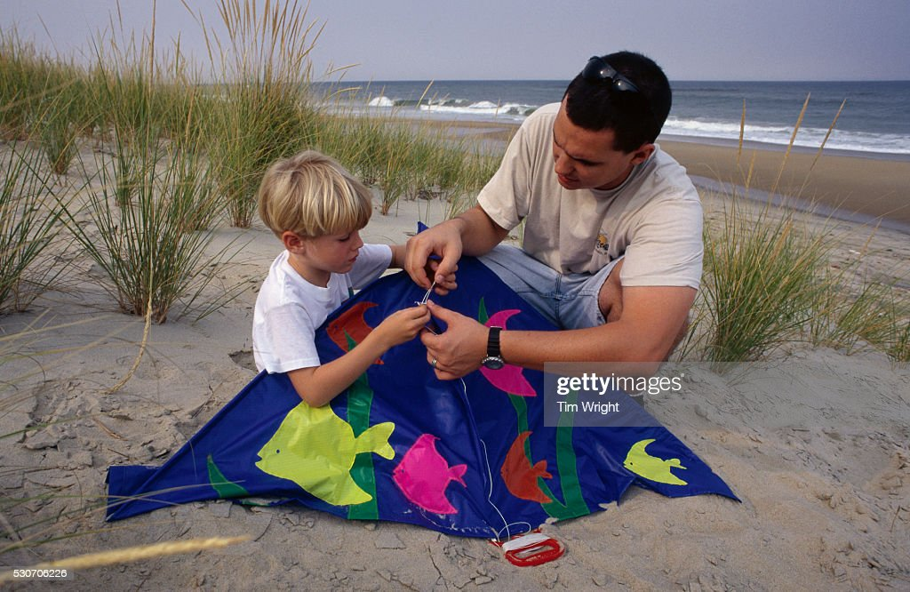 Man Helping a Boy with His Kite