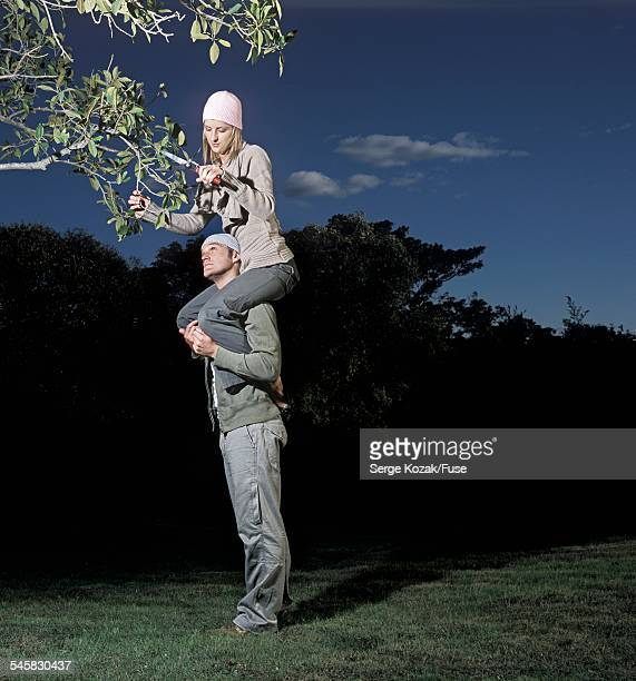 Man Helping Woman with Pruning
