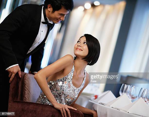 Man Helping Woman with Seat