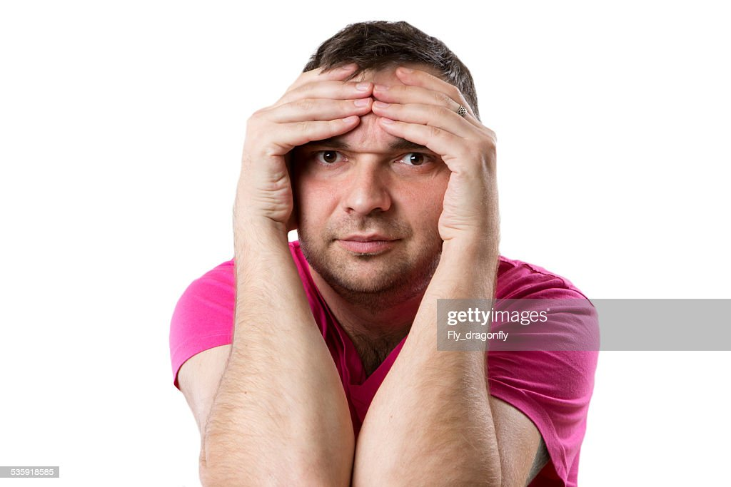 man hides his face covered hands : Stock Photo