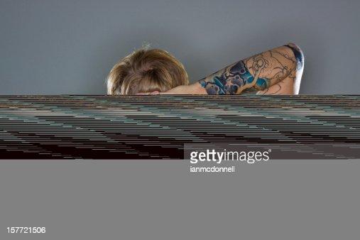 A man hiding a CGI log on a gray background