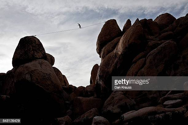 Man highlines over Hall of Horrors in Joshua Tree, Calif.