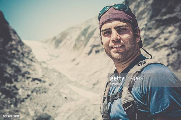 Man Hiker with Mountain and Glacier Background