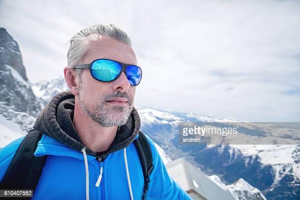 Man hiking and enjoying the winter