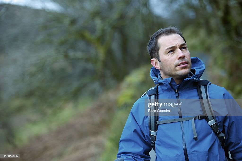 Man hiking in rural hillside