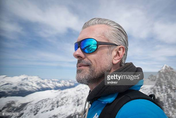 Man hiking in snow mountains