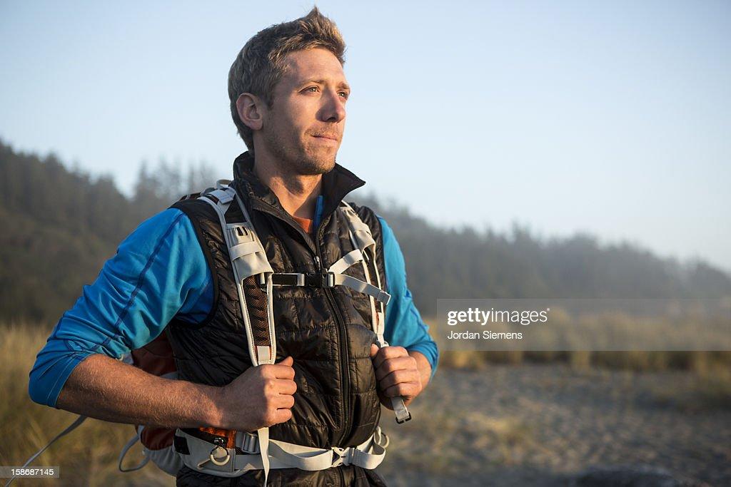 Man hiking near the ocean. : Stock Photo