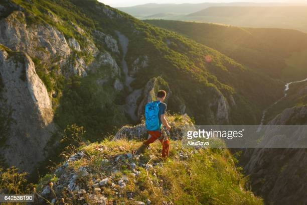 Man hiking outdoor in nature during sunset