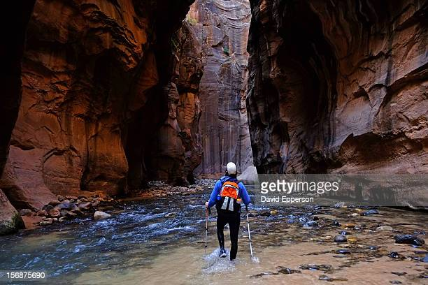 Man hiking The Narrows in Zion National Park