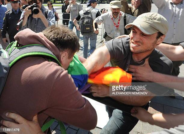 A man hits a gay rights activists during their attempt to hold an unauthorized rally in central Moscow on May 28 2010 Moscow police detained three...