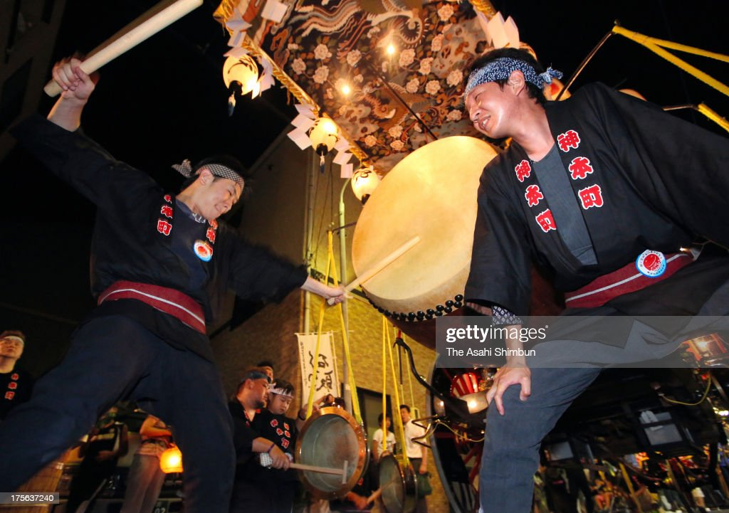 A man hits a Japanese taiko drum on the float called 'Saisha' or festival vehicle, during the Kuwana Ishidori Festival on August 3, 2013 in Kuwana, Mie, Japan. The 2-day festival, begins at the midnight on the first Saturday of August, is called 'Japan's noisiest festival'.