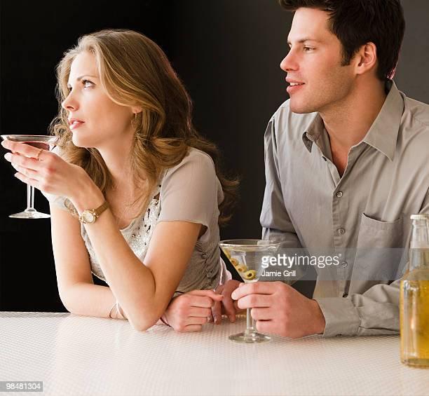 Man hitting on woman at bar