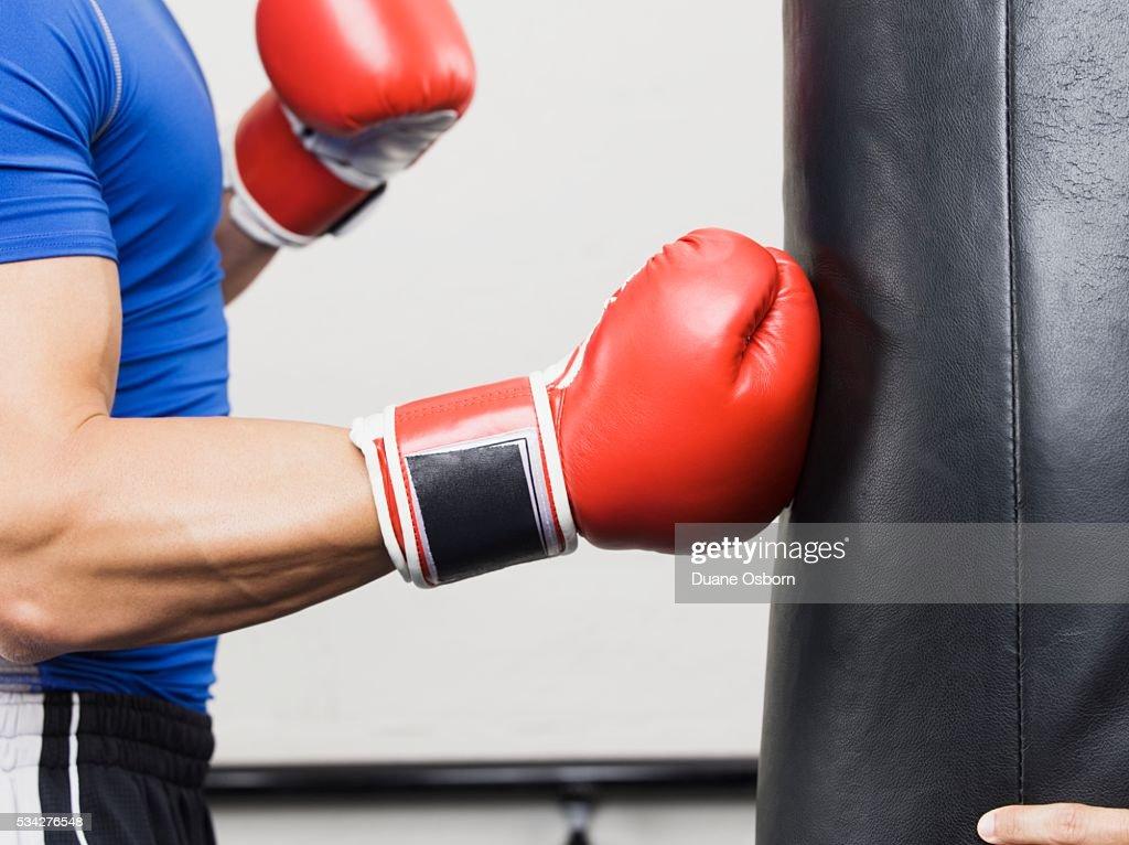 Man Hitting Punching Bag