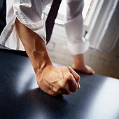 Man hitting table with fist, close-up